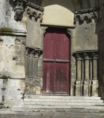 Bullet marked cathedral door
