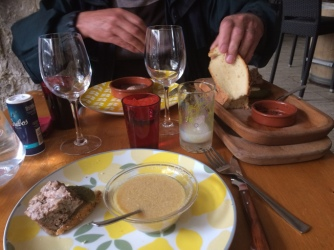 Duck and garlic soup, egg poached in wine and pork and veal pate