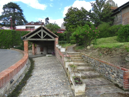 Canals lavoir with steps to the church