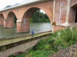 Stu exploring under bridge