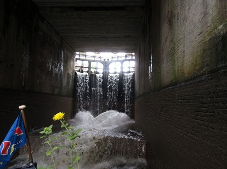 Water cascades into the lower lock