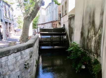 Ancient waterwheel in Rue de Teinctures