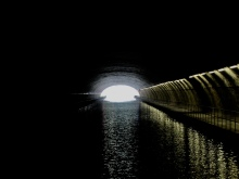 The short, wide tunnel leading to the lock