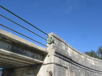 Leaving the lock under a pretty bridge
