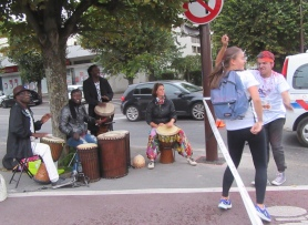 Drummers at the left turn after the bridge